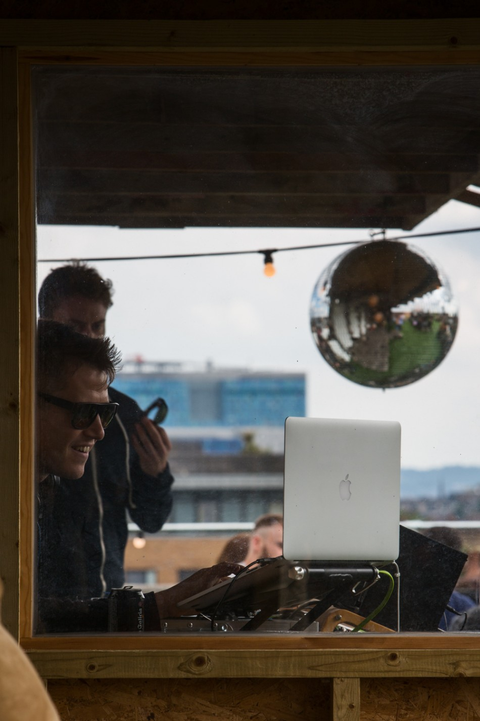 Hipsters on a rooftop bar in Broadway Market